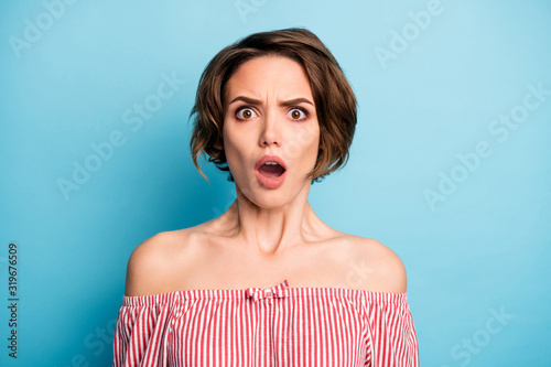 Fototapeta Closeup photo of crazy shocked lady open mouth listen unbelievable bad terrible news wear striped white red blouse open shoulders isolated blue color background obraz