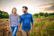 Smiling Couple Walking Through...