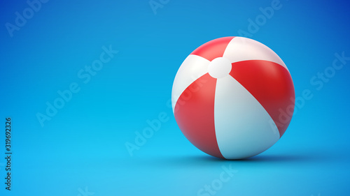 Stampa su Tela Red and white beach ball on blue gradient background