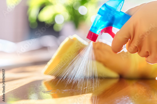 Obraz Cleaning with spray detergent, rubber gloves and dish cloth on work surface - fototapety do salonu