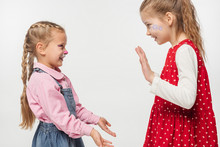 Excited Friends With Cat Muzzle And Floral Paintings On Faces Clapping Hands With Each Other Isolated On White