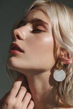 Fashion Beauty Portrait Of Young Beautiful Woman Wearing Earrings.
