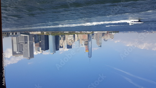 Motorboat Sailing In Sea By One World Trade Center Against Sky Canvas Print