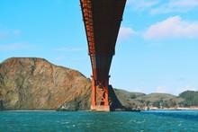 Bay Of Water Under Golden Gate Bridge Against Sky