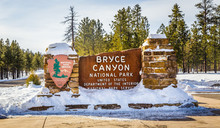 Bryce Canyon National Park Entrance Sign During Winter Covered With Snow