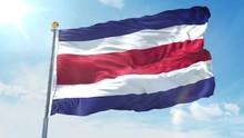 Costa Rica Flag Waving In The Wind Against Deep Blue Sky. National Theme, International Concept. 3D Render Seamless Loop 4K