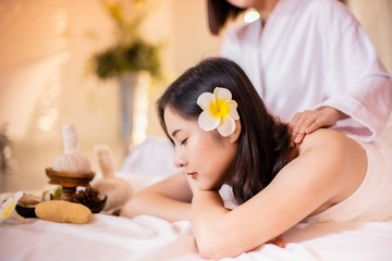 Obraz na płótnie Canvas Asian Beautiful, young and healthy woman in spa salon. Massage treatment spa room . Traditional medicine and healing concept.
