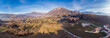 Leinwanddruck Bild - The panoramic view of the countryside in the mounains in Alps, morning light, Italy. Drone aerial panorama