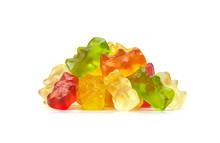 Macro Of Assorted Fruit Flavored Gummy Bears Or Cannabis Edibles Isolated On White Background
