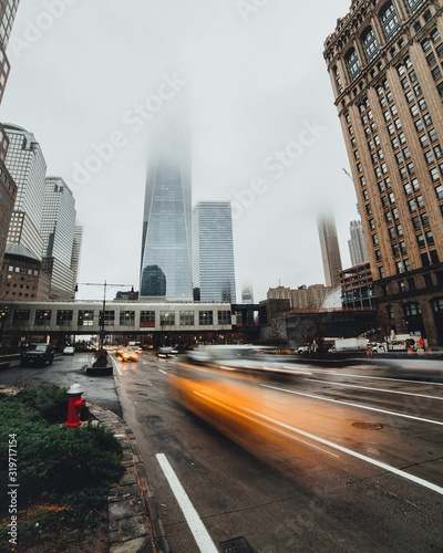 Blurred Motion Of Cars On Street Against One World Trade Center Canvas Print