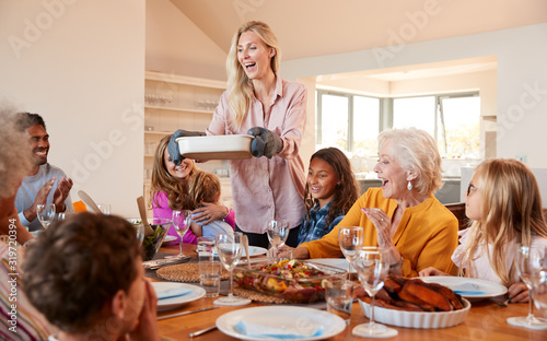 Fototapeta Mother Serving Food As Multi-Generation Family Meet For Meal At Home obraz