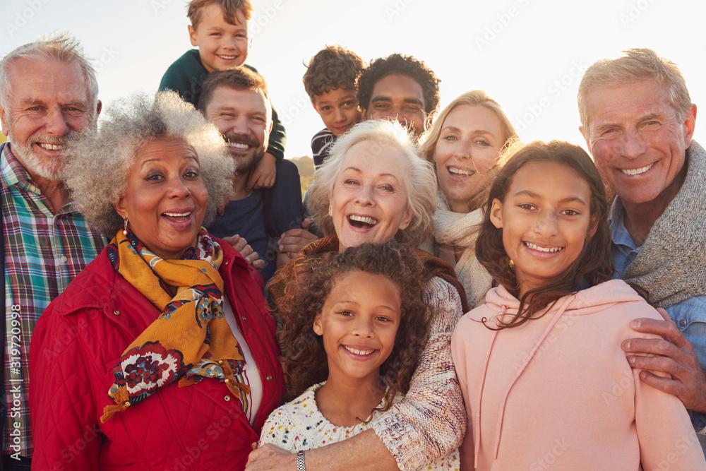 Fototapeta Portrait Of Multi-Generation Family Group On Winter Beach Vacation