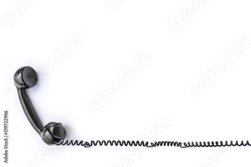 Photo Telefonhörer eines alten Telefons freigestellt vor weißem Hintergrund als Vorlag