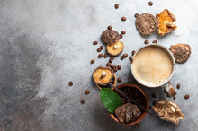 Mushroom Coffee, A Ceramic Cup, Mushrooms And Coffee Beans On Stone Concrete Background. New Superfood Trend.