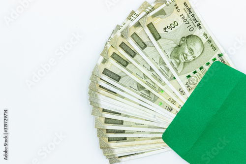 Photo New Indian 500 rupees, 500 rupees notes, Five Hundred New Indian Currency  in green envelope texture on white background, Success and got profit from business
