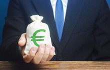 Man Holds Euro Money Bag. Granting Financing Business Project Or Education. Provision Cash Financial Credit. Profits Dividends. Donations And Philanthropy. Social Assistance. Investment. Award