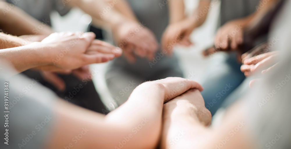 Fototapeta close up. a group of diverse young people holding hands