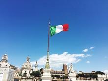 Low Angle View Of Italian Flag On Altare Della Patria