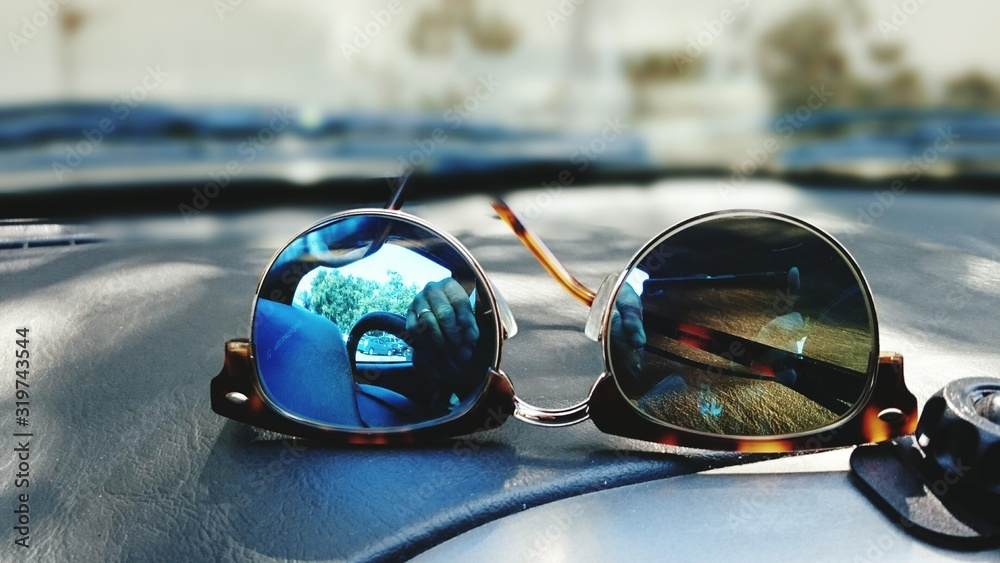 Fototapeta Close-Up Of Reflection On Sunglasses At Car Dashboard
