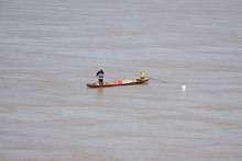 Thai And Laos People Riding Long Tail Boat For Catch Fishing In Mekong River At Wat Hin Mak Peng Temple In Nong Khai, Thailand