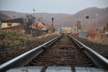 RAILROAD TRACKS ON LANDSCAPE
