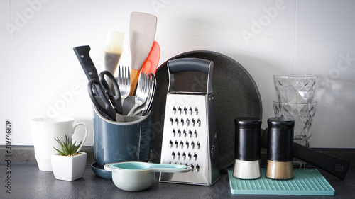 Fotomural Kitchen utensils on the background of the kitchen