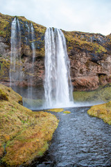 Fototapeta Wodospad Waterfall by the side of a mountain