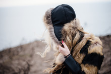 Young Woman Wearing Fur Jacket During Winter