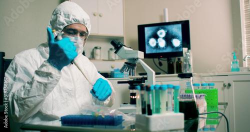lab tech with sample of Wuhan Coronavirus virus Wallpaper Mural