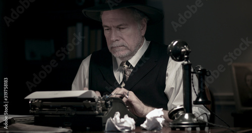1940s writer at his desk trying to finish his book Canvas Print