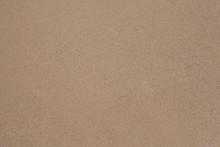 Sand Texture Background. Brown Sand. Background From Fine Sand.