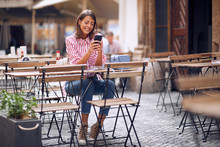Girl  Using Phone And Drinking...