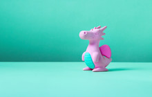 Cute Rubber Dragon Toy On Gree...