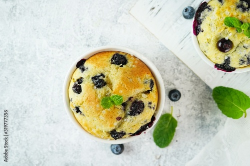 Homemade Blueberry Muffin for one baked in a ramekin, selective focus