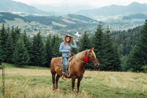 Female tourist on horseback at mountains Canvas Print