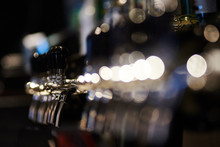 Close-Up Of Beer Taps At Microbrewery
