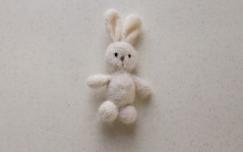 Handmade. Knitted White Bunny On A White Background