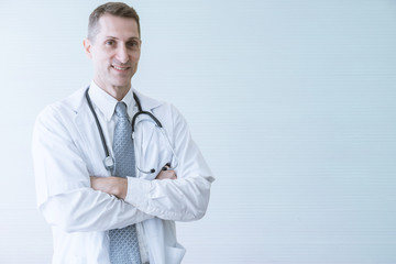 Portrait of confident medical doctor with smile and cross arms. Medical hospital concept. Copy space and isolated. clipping path