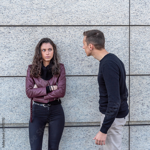A young couple in love during an argument, he tries to apologize, she looks at h Canvas Print
