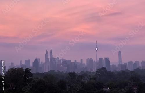 Fototapeta BUILDINGS IN CITY AGAINST SKY DURING SUNSET obraz