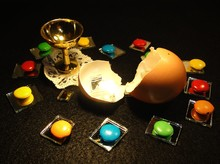 High Angle View Of Broken Eggshell With Colorful Candies