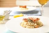 Fototapeta Kawa jest smaczna - Delicious chicken risotto served on table, closeup