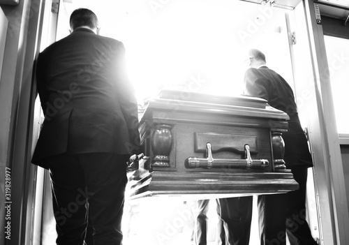 Photo Rear View Of People Carrying Coffin