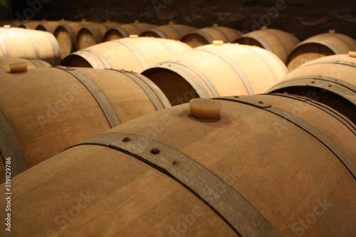 Close-Up Of Wine Barrels In Cellar Wallpaper Mural