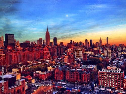 Fototapeta Manhattan Against Sky During Sunset obraz