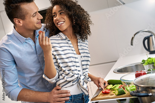 Young adult multi ethnic couple spending free time together at home