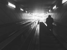Rear View Of Man On Escalator At Subway