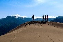 Man And Women Standing At Great Sand Dunes National Park And Preserve