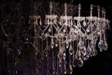 Close-Up Of Chandelier Hanging In Darkroom