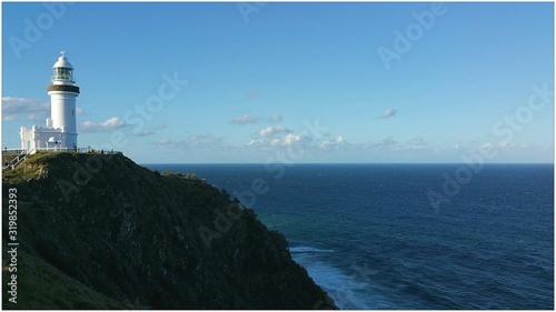 Fotografie, Obraz Cape Byron Lighthouse By Sea Against Sky
